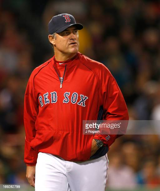 John Farrell of the Boston Red Sox walks to the dugout against the Minnesota Twins at Fenway Park on May 6 2013 in Boston Massachusetts Drew was...