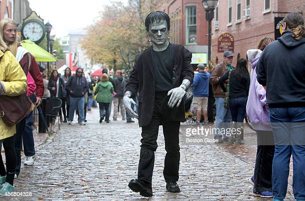 John Febonio of Lynn Mass strolls as Frankenstein down the Essex Street pedestrian mall during the October long preHalloween Haunted Happenings...
