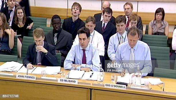 John Fiennes Cabinet Office Minister Ed Miliband and Sir Gus O'Donnell at the Public Administration Committee on government data losses in the Wilson...