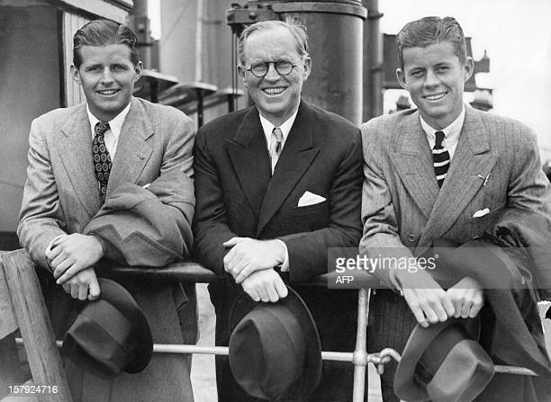 John Fitzgerald Kennedy and his brother Joseph Patrick Kennedy Jr surround their father Joseph on July 2 1938 in Southampton on the deck of French...