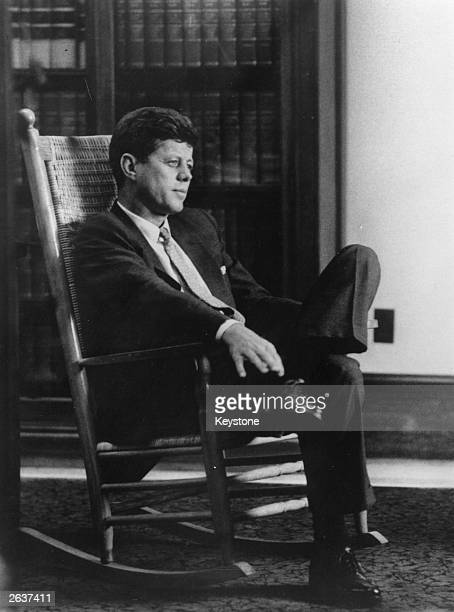 John Fitzgerald Kennedy the American president sitting in a rocking chair