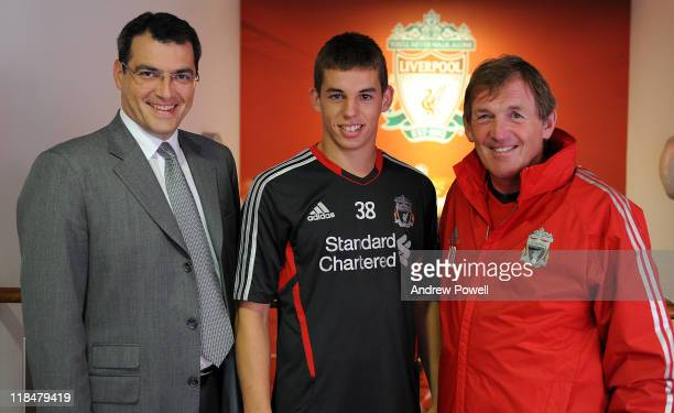 John Flanagan of Liverpool FC signs a new contract with Damien Comolli the Director of Football and Kenny Dalglish manager of Liverpool at Melwood...