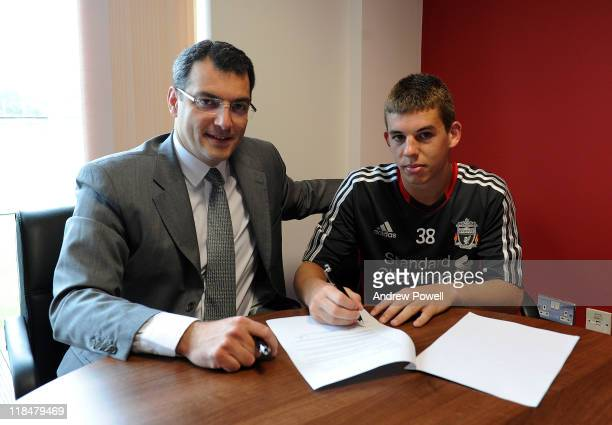 John Flanagan of Liverpool FC signs a new contract with Damien Comolli the Director of Football at Melwood Training Ground on July 8 2011 in...