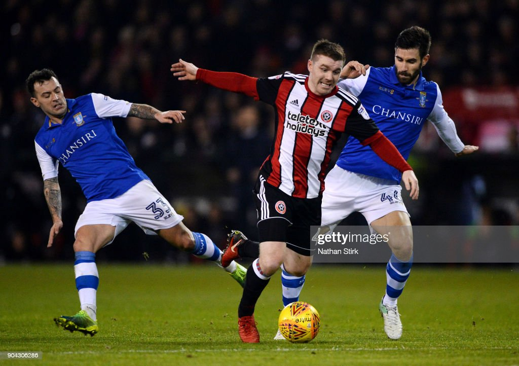 John Fleck of Sheffield United and Frederico Venancio of Sheffield Wednesday in action during the Sky Bet Championship match between Sheffield United and Sheffield Wednesday at Bramall Lane on January 12, 2018 in Sheffield, England.