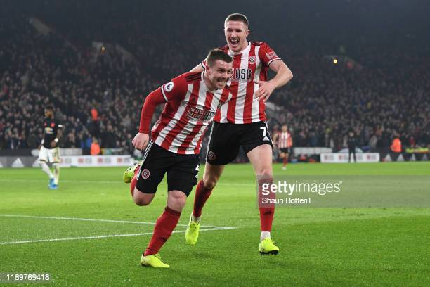 John Fleck of Sheffield United celebrates after scoring his sides first goal with teammate John Lundstram during the Premier League match between...