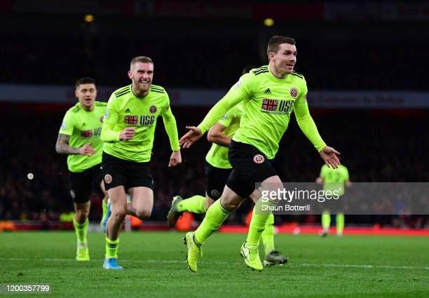John Fleck of Sheffield United celebrates after scoring his sides first goal during the Premier League match between Arsenal FC and Sheffield United...