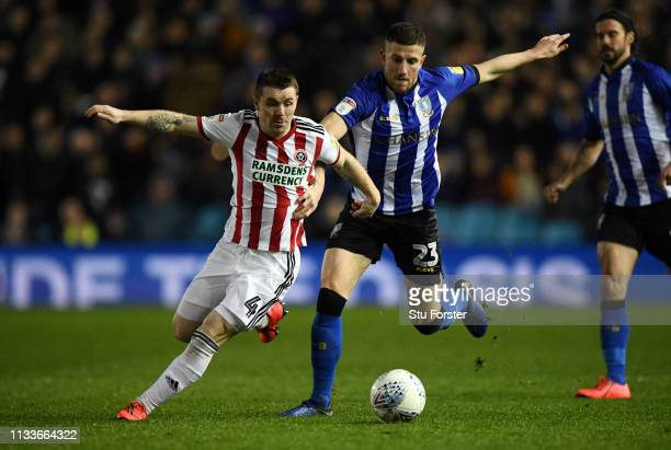 John Fleck of Sheffield United competes with Sam Hutchinson of Sheffield Wednesday during the Sky Bet Championship match between Sheffield Wednesday...