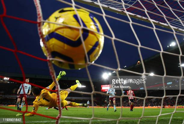 John Fleck of Sheffield United scores his team's first goal past Tom Heaton of Aston Villa during the Premier League match between Sheffield United...