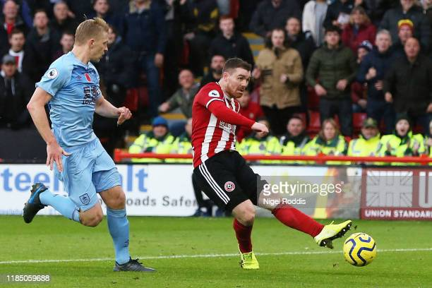John Fleck of Sheffield United scores his team's third goal during the Premier League match between Sheffield United and Burnley FC at Bramall Lane...
