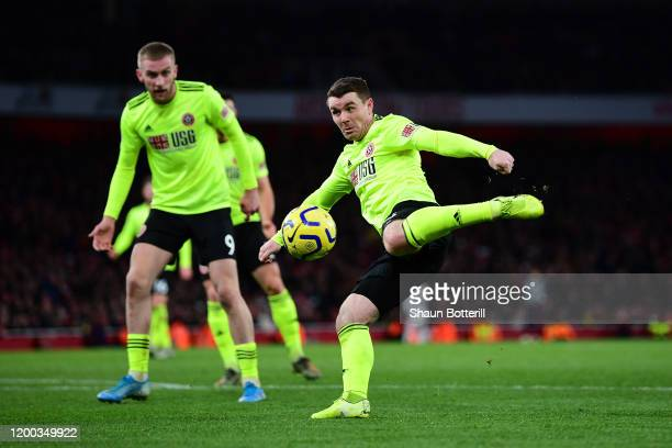 John Fleck of Sheffield United shoots and scores his sides first goal during the Premier League match between Arsenal FC and Sheffield United at...