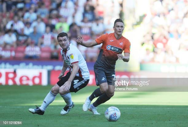 John Fleck of Sheffield United vies for possession with Connor Roberts of Swansea City during the Sky Bet Championship match between Sheffield United...