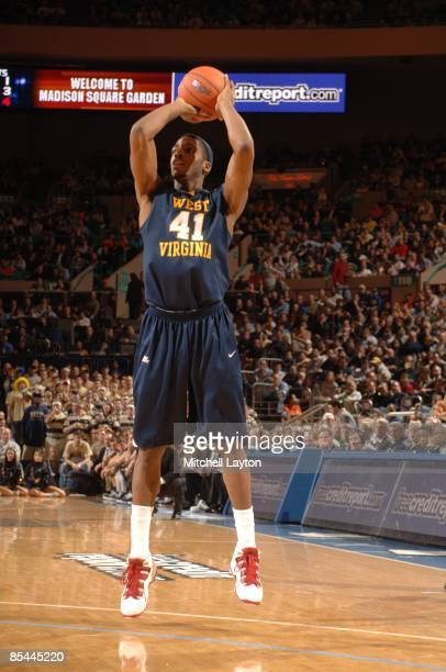 John Flowers of the West Virginia Mountaineers takes a jump shot during a quarterfinal Big East Conferance Touranment college basketball game against...