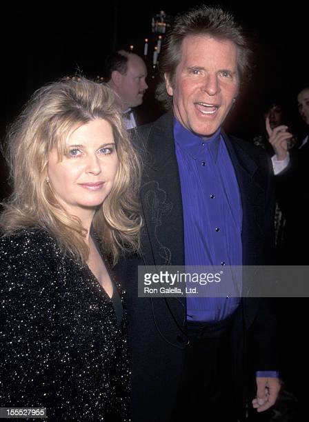 John Fogerty and wife Julie Lebiedzinski attend the 40th Annual Grammy Awards PreParty hosted by Clive Davis and Arista Records on February 24 1998...