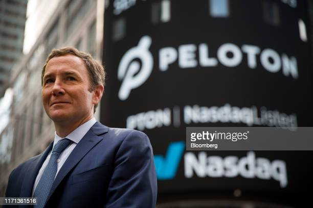 John Foley, co-founder and chief executive officer of Peloton Interactive Inc., stands for a photograph during the company's initial public offering...