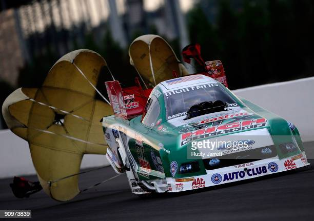 John Force driver of the Castrol GTX High Mileage Ford funny car drives during qualifying for the NHRA Carolinas Nationals on September 19 2009 at...