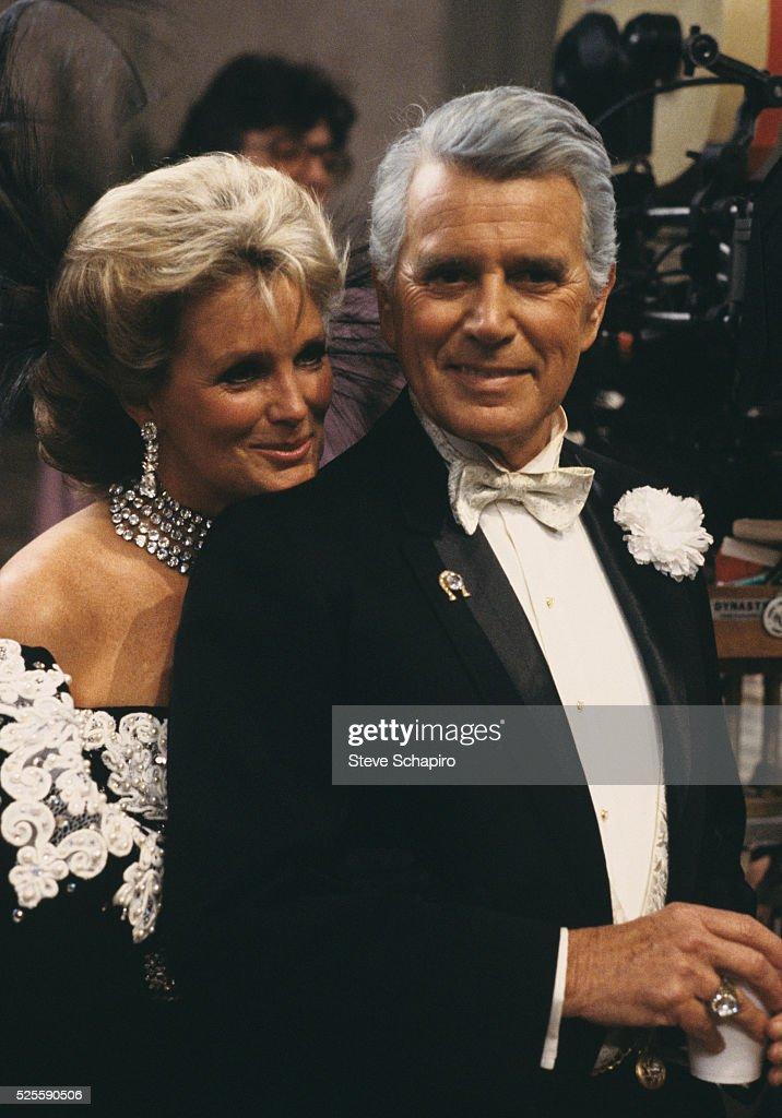 John Forsythe and Linda Evans on set of Dynasty