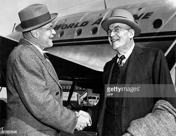 John Foster Dulles , Republican Party Foreign policy expert is greeted by his brother, Allan Dulles, as he arrives 04 October 1948 in New York. J. F....
