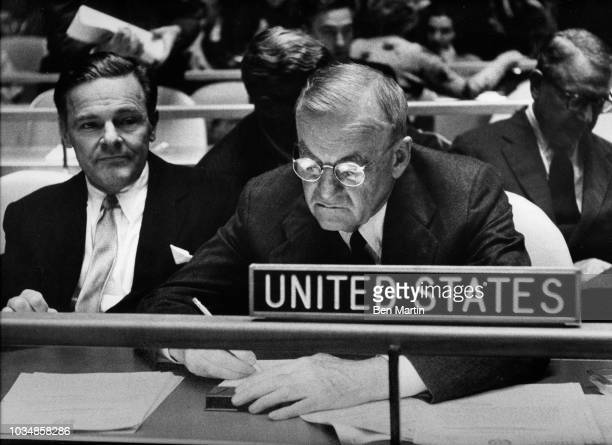 John Foster Dulles Secretary of State in Eisenhower administration seated next to Henry Cabot Lodge II while addressing a United Nations session...