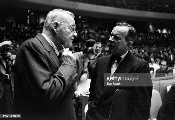 John Foster Dulles Secretary of State in Eisenhower administration conferring with Canadian Minister Lester Pearson in a United Nations Session, New...