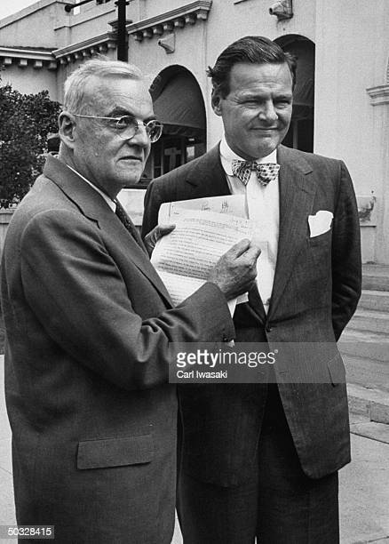 John Foster Dulles showing mutual defense pact to Henry Cabot Lodge Jr.