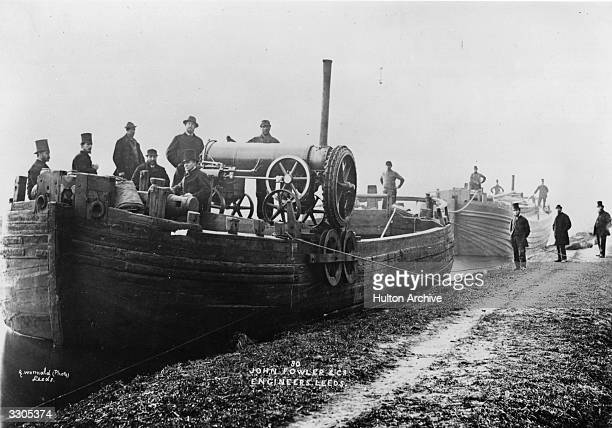 John Fowler clip drum type steam ploughing engine mounted on a barge for cultivating tracts of land intersected by canals