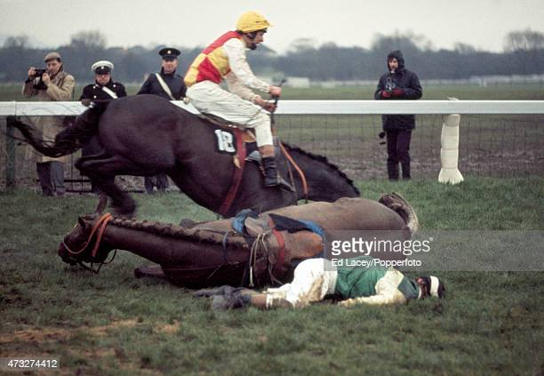 John Fowler of Ireland falls from Rag Trade giving John Mead riding Mr Shut Eye the lead during the Fulke Walwyn Kim Muir Memorial Challenge Cup...