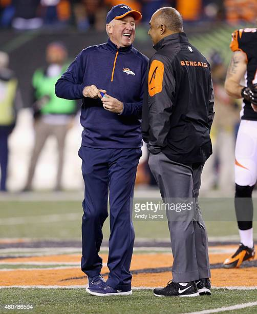 John Fox the head coach of the Denver Broncos and Marvin Lewis the head coach of the Cincinnati Bengals talk before the game at Paul Brown Stadium on...
