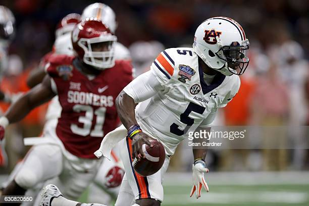 John Franklin III of the Auburn Tigers scrambles with the ball against the Oklahoma Sooners during the Allstate Sugar Bowl at the MercedesBenz...