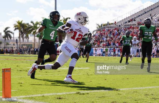 John Franklin III of the Florida Atlantic Owls scores a touchdown during the first half of the Conference USA Championship game against the North...
