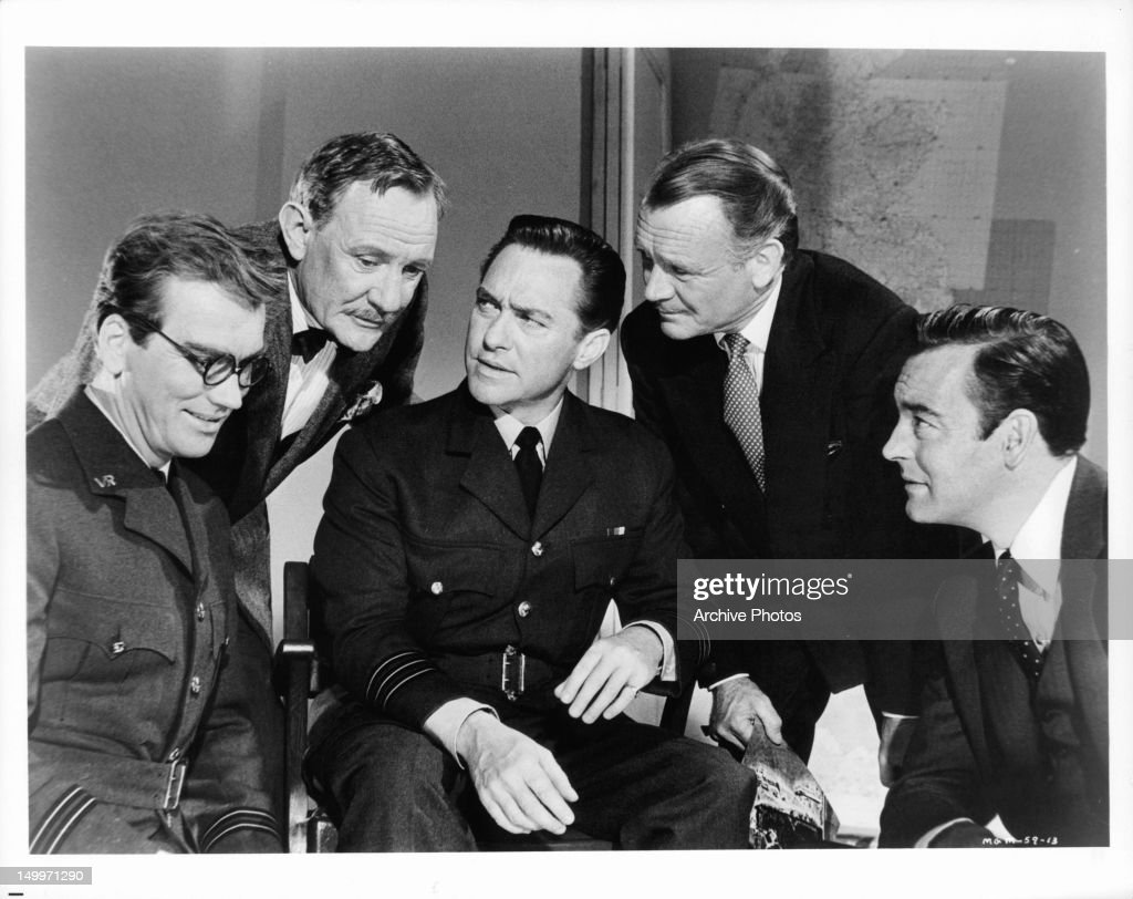 John Fraser, Trevor Howard, Richard Todd, John Mills, and Richard Johnson from part of a committee appointed by Winston Churchill to investigate the reports surrounding Hitler's V-Weapons in a scene from the film 'Operation Crossbow', 1965.