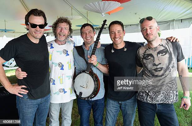 John Frazier and Sam Bush with Dave Johnston Adam Aijala and Ben Kaufmann of Yonder Mountain String Band backstage at What Stage during day 4 of the...