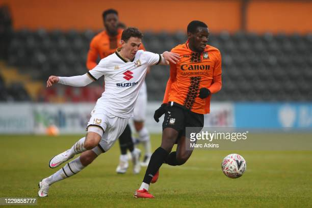 John Freeman of MK Dons in action with Wesley Fonguck of Barnet during the Emirates FA Cup Second Round match between Barnet FC and Milton Keynes...