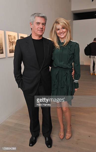 John Frieda and Avery Agnelli attend the private view of The Macallan Masters of Photography with Albert Watson at Phillips de Pury And Company on...