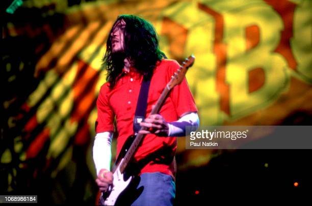 John Frusciante of the Red Hot Chili Peppers performs on stage at the World Music Theater in Tinley Park Illinois September 5 1997