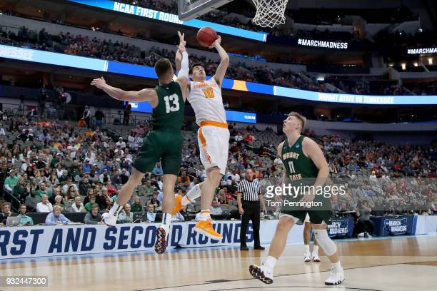 John Fulkerson of the Tennessee Volunteers goes up for a shot between Grant Benzinger and Loudon Love of the Wright State Raiders in the first half...
