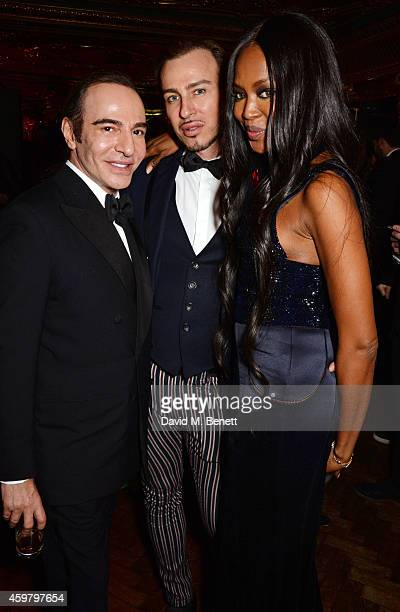John Galliano Alexis Roche and Naomi Campbell attend a party in celebration of Edward Enninful in The Oscar Wilde Bar Hotel Cafe Royal on December 1...