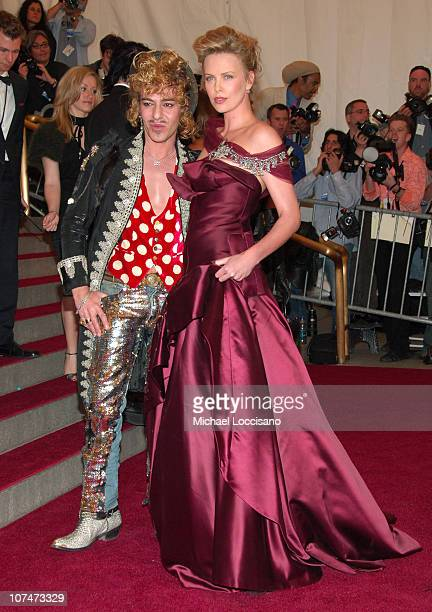 John Galliano and Charlize Theron during AngloMania Costume Institute Gala at The Metropolitan Museum of Art Arrivals Celebrating AngloMania...