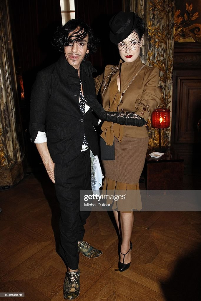 John Galliano and Dita von Teese attend the John Galliano Ready to Wear Spring/Summer 2011 show during Paris Fashion Week at Opera Comique on October 3, 2010 in Paris, France.