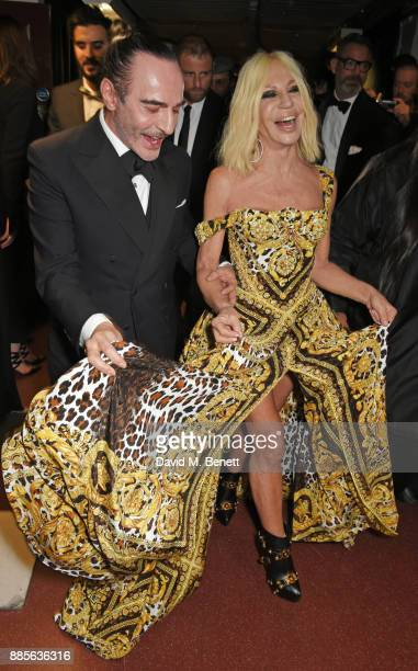 John Galliano and Donatella Versace pose backstage at The Fashion Awards 2017 in partnership with Swarovski at Royal Albert Hall on December 4 2017...