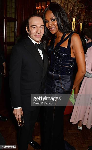 John Galliano and Naomi Campbell attend a party in celebration of Edward Enninful in The Oscar Wilde Bar, Hotel Cafe Royal, on December 1, 2014 in...