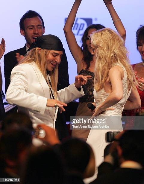 John Galliano and Sharon Stone during amfAR's Cinema Against AIDS Benefit in Cannes, Presented by Bold Films, Palisades Pictures and The Weinstein...