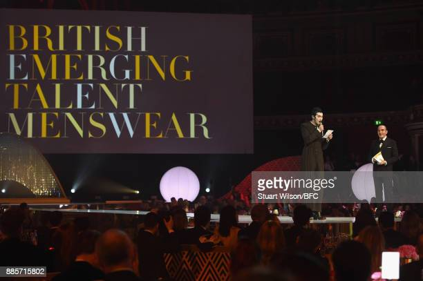John Galliano presents Charles Jeffrey with his award during The Fashion Awards 2017 in partnership with Swarovski at Royal Albert Hall on December 4...
