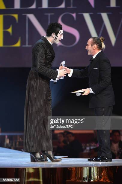 John Galliano presents the award for British Emerging Talent Menswear to Charles Jeffrey for Charles Jeffrey LOVERBOY on stage at The Fashion Awards...