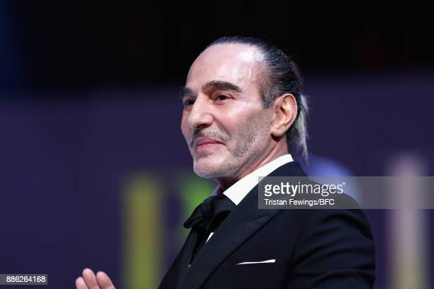 John Galliano presents the British Emerging Talent Menswear award on stage during The Fashion Awards 2017 in partnership with Swarovski at Royal...