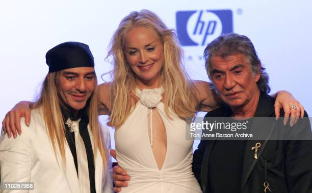 John Galliano, Sharon Stone and Roberto Cavalli during amfAR's Cinema Against AIDS Benefit in Cannes, Presented by Bold Films, Palisades Pictures and...