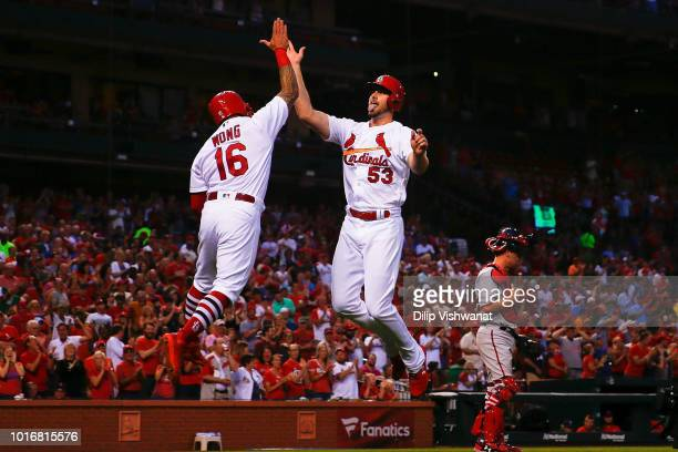 John Gant of the St Louis Cardinals celebrates after hitting a tworun home run against the Washington Nationals second inning at Busch Stadium on...