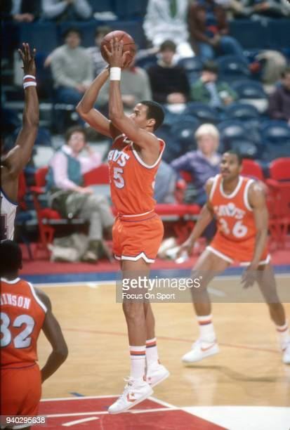 John Garris of the Cleveland Cavaliers shoots against the Washington Bullets during an NBA basketball game circa 1984 at the Capital Centre in...