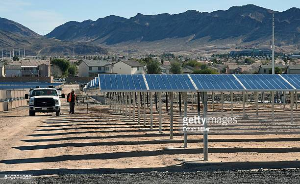 John Gatlin of Greenbotics walks between rows of solar panels during a dedication ceremony to commemorate the completion of the 102acre 15megawatt...