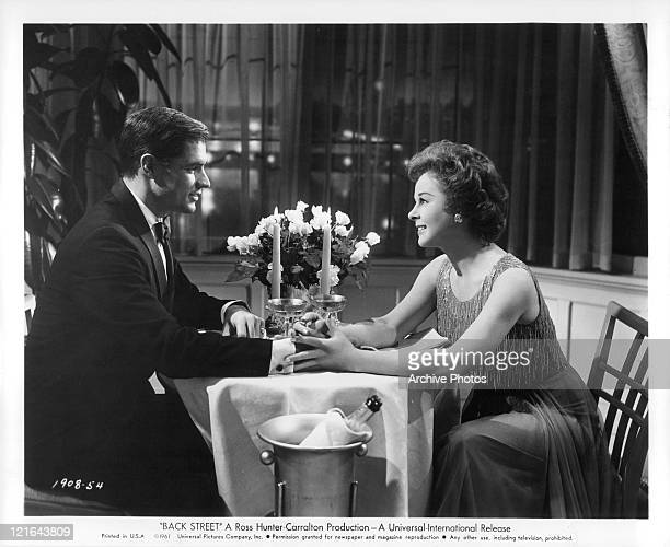 John Gavin and Susan Hayward holding hands in a scene from the film 'Back Street' 1961