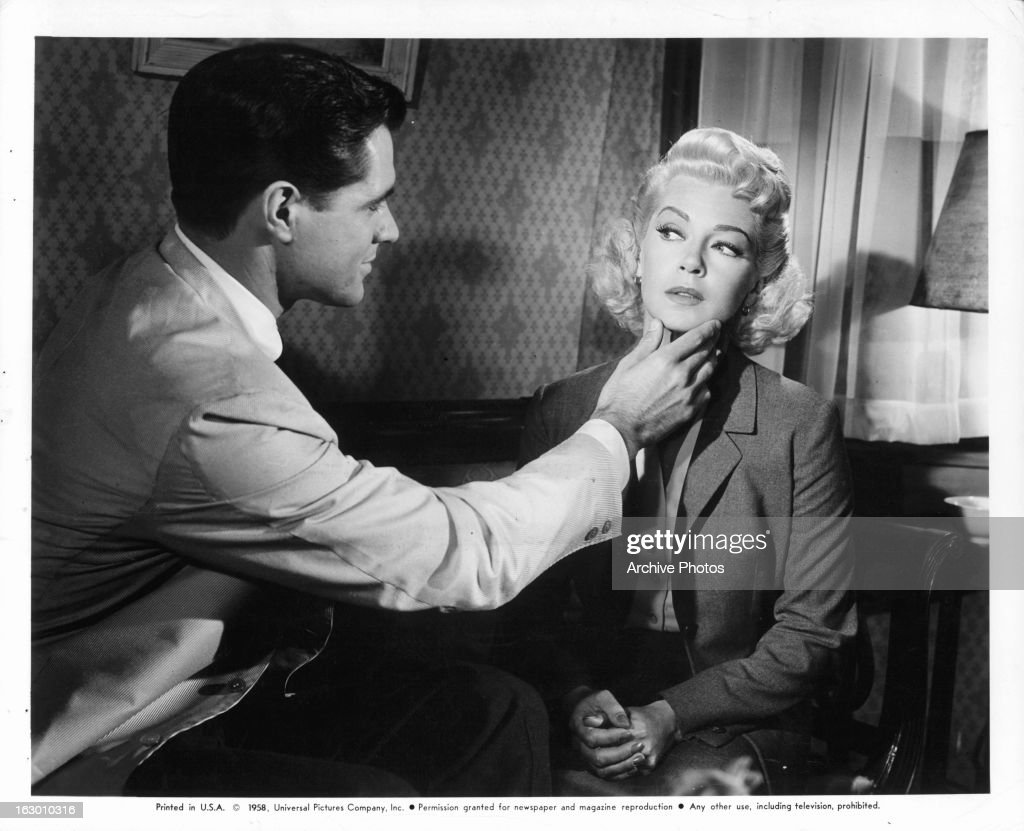 John Gavin touches Lana Turner in a scene from the film 'Imitation Of Life', 1959.